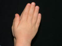 Child's Hands in Prayer